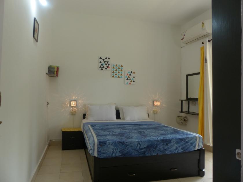 Laze- bedroom with bedside tables