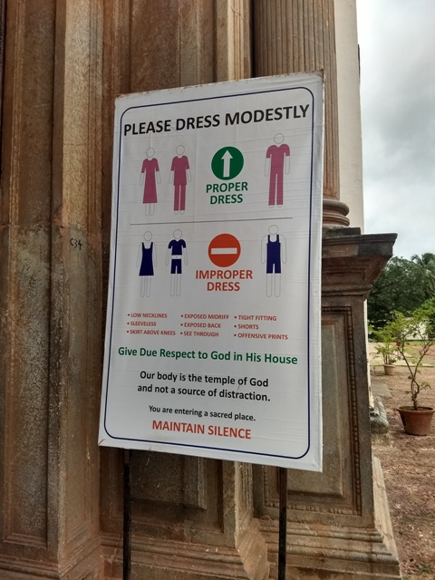Placard informing the visitors to be dressed appropriately